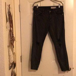 Black distressed pistola skinny jeans